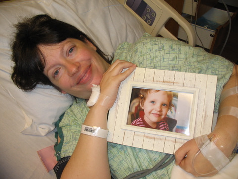 Mama holding photo of Donna