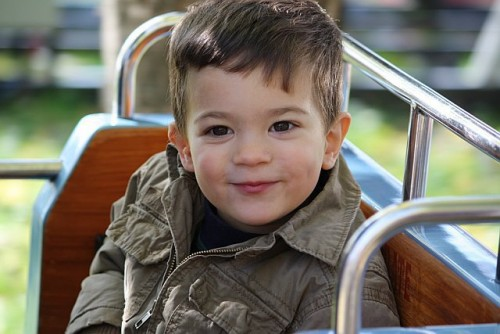 "This is Aidan.  He loved dinosaurs and trains and Buzz Lightyear.  He had exceptional taste in music at such a tender age.  Elvis Presley's ""Suspicious Minds"" was a favorite to dance to.    Photo October 2009"