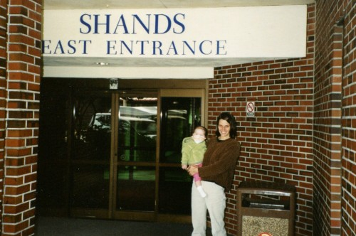 Isabelle and her Mom, Annie, at the entrance to Shands