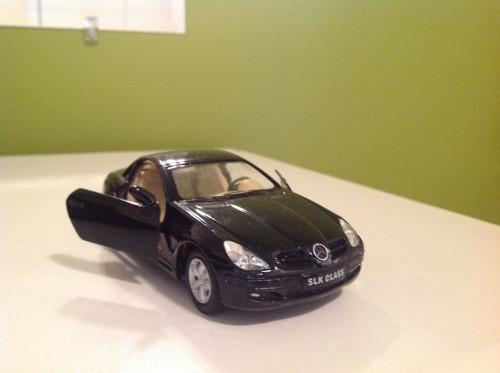 This toy Mercedes will now have to suffice.  And honestly?  It's not much smaller than the actual car.  As much as I loved my Mercedes, ain't no way a compact C Class was gonna cut it for a family of four.