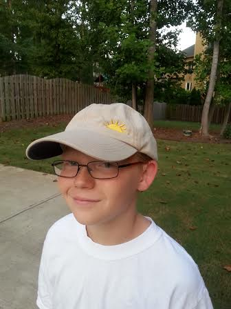 Matthew's younger brother, Cameron, wearing the hat.