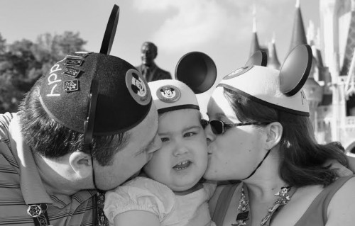 Disney smooches from Mom and Dad