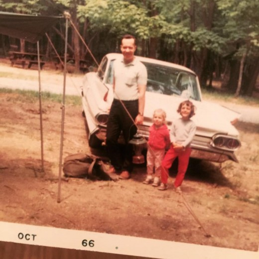 A man, his bumper, and 2 of 3 daughters.