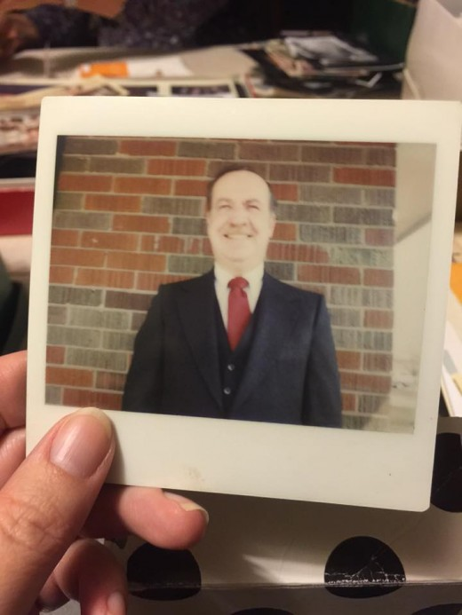 A Polaroid of my Dad looking dapper in his suit.  Early 1980s.